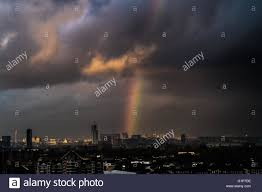 uk 18th may 2016 uk weather colourful rainbow breaks