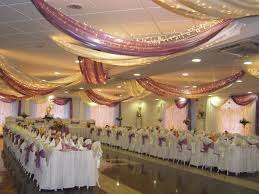 white purple wedding dining hall decoration with beautiful curtain