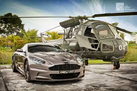 silver aston martin vanquish photo of the day silver aston martin dbs with army helicopter