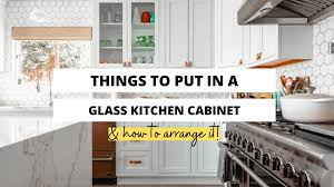 how do you arrange dishes in kitchen cabinets what do you put in glass kitchen cabinets craftsonfire