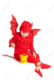 little devil halloween costume little boy in red devil costume sitting with bucket over white