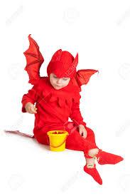 little devil halloween costume little boy in red devil costume sitting with bucket over white