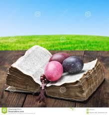 wooden easter eggs that open easter eggs and an open bible wooden table royalty free stock