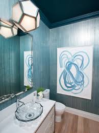 contemporary powder room with abstract wall art and blue
