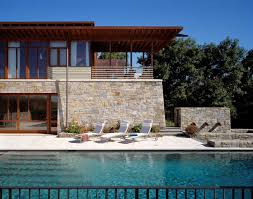 beautiful stone and wood house with indoor swimming pool as