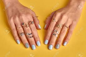 hand finger rings images Female hands with manicure closeup many beautiful gold rings jpg
