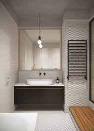 soft pink tiles soften the appearance of this bathroom