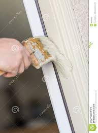 professional painter cutting in with brush to paint house door f