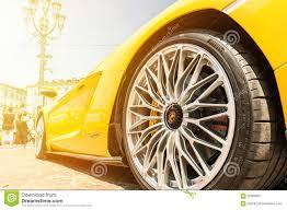 Yellow Lamborghini Aventador - close up of a yellow lamborghini aventador editorial photography