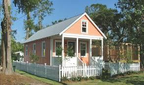minimalist modular home exterior design in white striped scheme