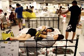 ikea fans customers beat the heat by napping on furniture in ikea s beijing