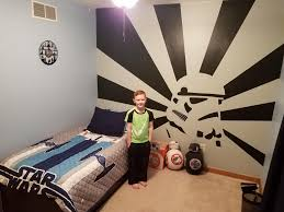 my s new bedroom wall i painted for him starwars