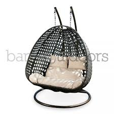 double hanging pod chairs bare outdoors