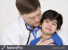 Doctor Comforting Patient Photo Of Male Doctor Comforting Scared Toddler Patient