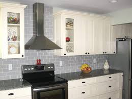 interior kitchen subway tile backsplash with mosaic deco band