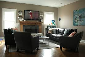 living room with lcd tv and fireplace black leather sofa sethome