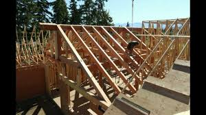 Danforth Roofing Supplies by Roofing Timbers U0026 Workmen Unloading Delivery Of Roof Trusses From