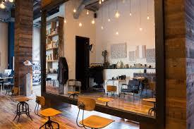 inside hair salon and art gallery three squares studio coveteur