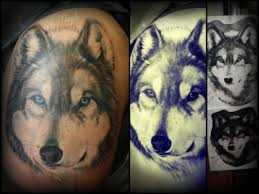style black and gray wolf half sleeve with blue