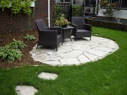Zen Backyard Ideas - great backyard patio ideas with stone floor with black chair and