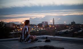 roof sitting plaid blanket watches town lights