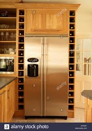 built in kitchen designs stainless steel fridge and built in wine rack storage in kitchen