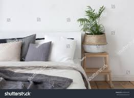 bedroom interior bed bedside table plant stock photo 640041676 bedroom interior bed and bedside table with plant