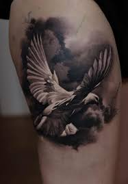 collection of 25 clouds and white pigeon tattoos on shoulder