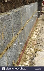 low density concrete block inner garden wall with wall ties stock