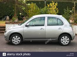 nissan small car nissan micra spirita small saloon car side view stock photo