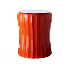 nursery accent table orange hex lacquer accent table placed next to the glider this