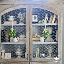 how to style a bookcase like a boss chicken wire cabinets