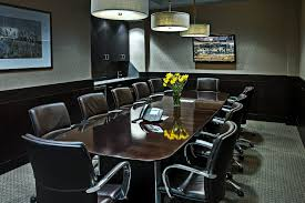 modern conference room chairs and fur rug also oval wooden meeting