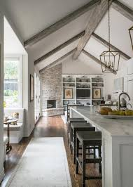 white contemporary kitchen with vaulted ceilings nature inspired