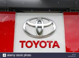 a toyota a big toyota logo on the side of a toyota car dealership stock