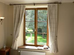 decorating ideas to window treatments for casement windows homesfeed simple white stripe shades for natural wooden casement windows with ivory walls and natural wooden side