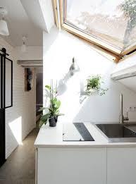 parisian attic apartment blends rustic with contemporary collect this idea kitchen sink attic apartment paris