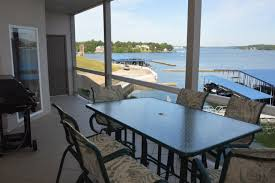 lake of the ozarks vacation condo rentals osage beach condo 104 2 story 4 bedroom 4 bath gorgeous main channel view two master bedrooms attached bath with jetted tubs contact carolyn s condos 309 472