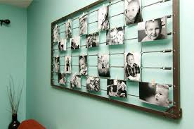 unique ways to hang pictures 25 creative ways to display your photos goedeker s home life