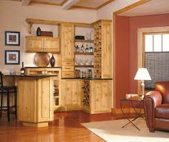what color flooring goes with alder cabinets rustic alder cabinets in bar area cabinets