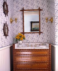 coastal home design powder room tropical with wood framed mirror