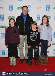 london uk 111213 frankie dettori and children at the guide dog