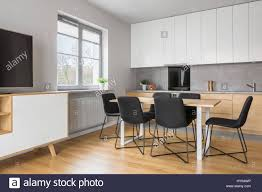grey and white kitchen grey and white apartment with kitchen open to tv living room stock