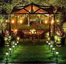 graceful garden with romantic view of fair lighting fixtures also