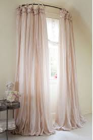 use a curved shower curtain rod to make a window look bigger 15