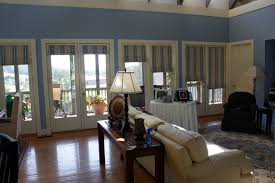interior blue window roller shades for door and transom combined