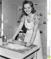 young woman rolling out dough in the kitchen stock photo image