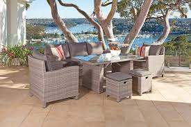 a hybrid of lounge and dining this shelta dining setting suits