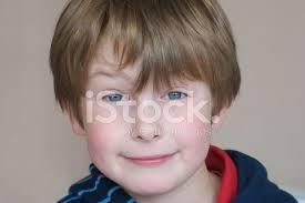 4 year old boy smirking blue eyes brown hair stock photos