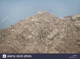Kurdish Flag A Kurdish Flag Is Embedded On A Mountaintop Overlooking The City